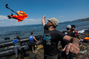 A refugee throws away his life jacket after making the crossing from Turkey to Greece. More than 30,000 refugees have reached the Greek island of Lesvos during August 2015, according to Amnesty International. August 25, 2015, Lesvos, Greece
