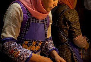 Food vendor in Muslim Qtr., Xian, China. (Orange Girl)