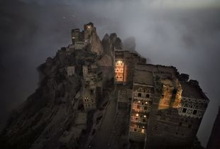 Shugruf, Yemen: The morning mist rises mystically from the valley towards the small town in the Haraz mountains. © Matjaz Krivic