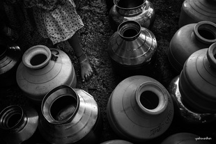 Girl and empty containers.