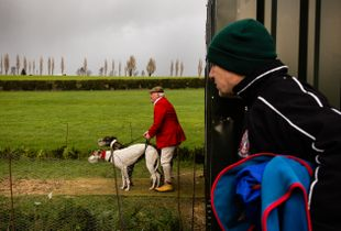 A dog owner is seen watching greyhounds being released during National Coursing Meeting in Clonmel, Co. Tipperary, Ireland. 30 Jan 2016.