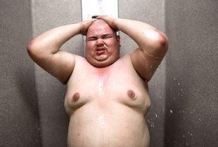Fat Joe takes a shower after chain gang duty in Estrella Jail in Phoenix, Arizona.