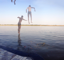 Boys jump into the Ganges