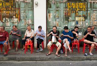 Men having lunch in the street, Chinatown, Bangkok 2017
