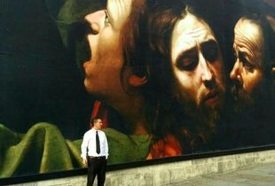 A man and a mural.