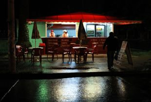 A quiet rainy night at the snack stall.