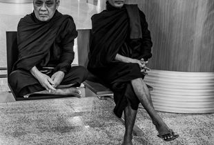 Buddhist Monks waiting for their flight back to Myanmar (Burma) from Thailand.