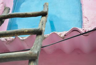 Ladder to access the first floor of one of the house in Outram Lines slums, North Delhi.