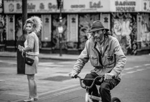 Man on Small Bike