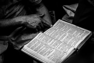 Taken in Managua , Nicaragua. A person in a market trying to teach the Bible.