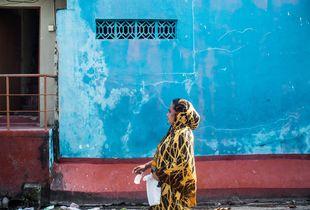 A woman walking in the neighbourhood.