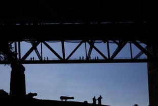 Bridge Walk Tour and Tourists Looking Up