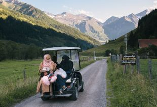Exploring the valley in a golf cart.