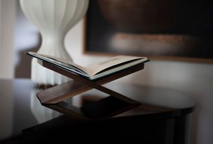 Custom made walnut stands, produced locally in Ottawa Canada beautifully display each Special Edition copy of TRANSFIGURATION.