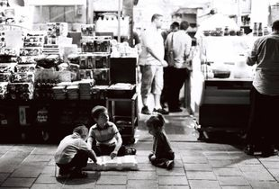 """children playing in the shuk"""