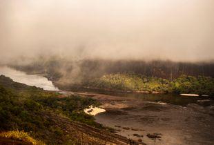 Sunrise over Amazon Rainforest. Inírida River.