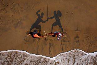 Live shot of two kalaripayat fighters training on the beach in Kozhikode. Kalaripayat is the ancient martial art form from Kerala, said to be older than kung fu. Please note that this pic has NOT been staged AT ALL.