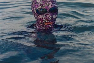 A woman with a mask face-kini