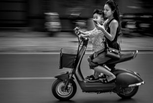 Somewhere in Hanoi. Who is driving — mother or son?