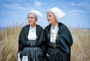 Two Breton women at a Pardon Ceremony in Brittany.  From The series Days Of Mercy