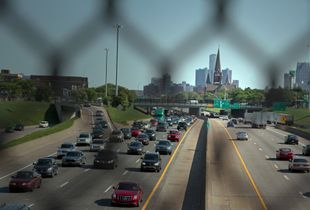 This stretch of I-75 was Paradise Valley, home to 75% of Detroit's blacks in the 1940's. The Housing Act of 1949 made federal money available for Detroit to implement a slum clearance plan. Home to more than 400 black-owned businesses, Paradise Valley was demolished in 1958. The one-mile stretch of I-375 was completed in 1964 and wiped out Black Bottom, also a black enclave. © Nicholas Gregory