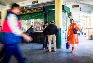 Men conversing at Railway Station, Darjeeling.