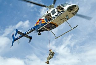 DPS Officer Rappelling from Helicopter