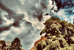 Dramatic clouds rising .