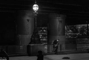 Saxo player under the bridge