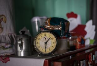 5 - A clock on top of the kitchen refrigerator