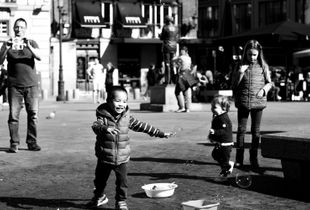boy hunting soap bubbles