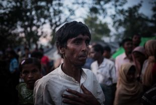 The Rohingya Refugee Crisis. A torn up Rohingya refugee, just arrived on foot from Burma, is waiting in one of the huge camps for water and food supplies. Near Ukhia, Bangladesh.