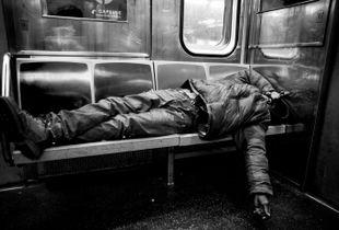 homeless man on the 1 train