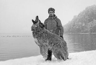 Russian farmer with his dog