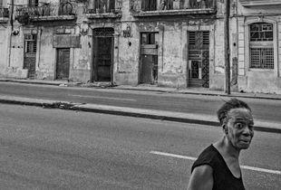 Woman passing trough in old Havana, Cuba