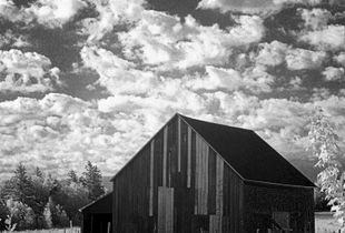 Old barn with clouds