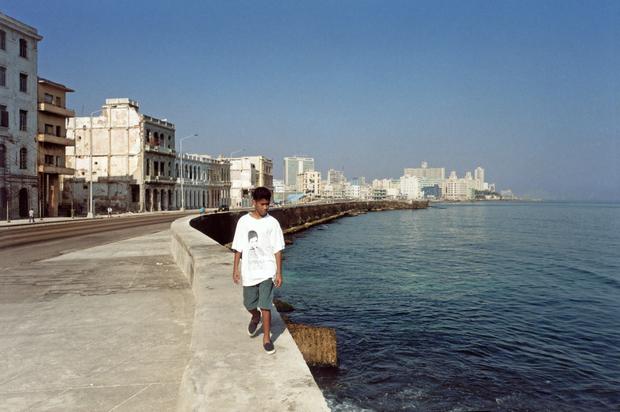 "A boy wearing a T-shirt that says ""Let's save Elián.""  Havana, 2000"