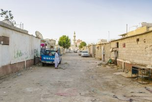 then - Street in Shabiya 12 leading to thelocal mosque. I liked the vanishinglines to the mosque. Shot on March 2013