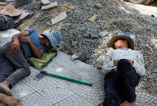 Construction Workers Napping in the Shade in the Heat of an Afternoon in Da Nang