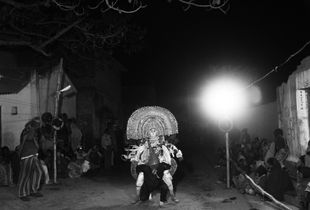 Chhau dancers are performing in the dead night in a remote village.