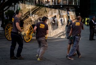 Men Carrying a Pane of Glass