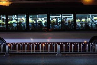 Migrant workers on buses
