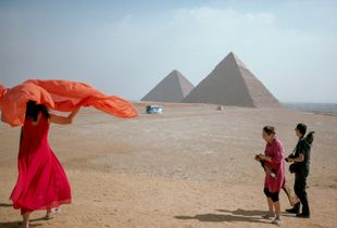 Tourists take in the view from behind the Pyramid complex at Giza, Egypt.