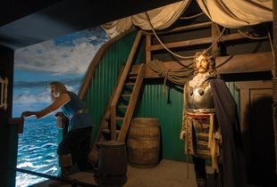 European explorer LaSalle and crew sail into the New World in a reasonably accurate diorama. Wax museum of History, Niagara Falls, New York.