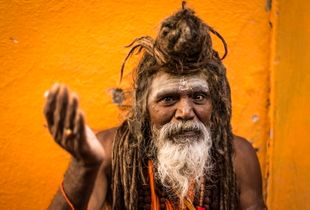 Shaivas Sadhu or Shiva worshiping Indian holy man giving 'darshan' or a blessing, Kumbh Mela, India,  2015.