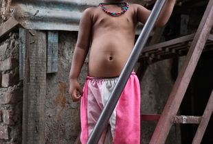 Child on the stairs to their home, Dharavi
