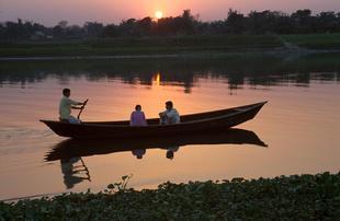 Man rowing couple for a romantic moment along the riverSavar waterfront near Dhaka, Bangladesh