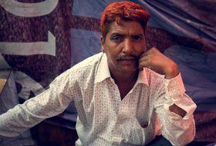Vendor at a street market, Mumbai, India.