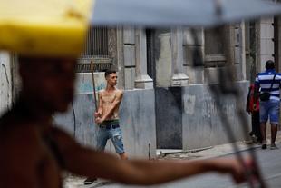 Playing baseball with a stick -Havana