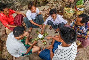 Friends Playing Game on Sidewalk